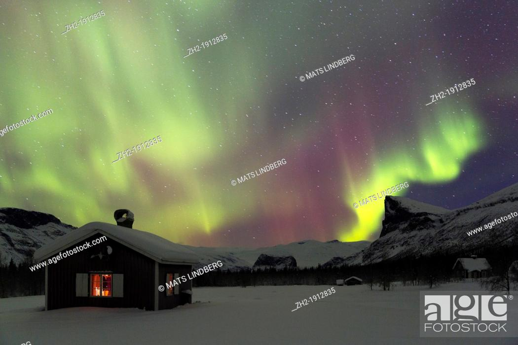 Stock Photo: Northernlight in Sarek national park in swedish lapland with a cottage in winter time.