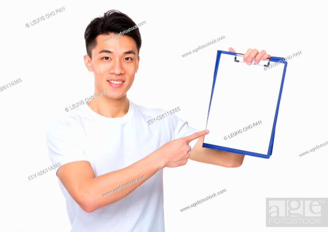 Stock Photo: Young man show with the blank page of clipboard.