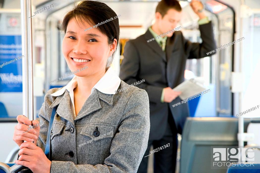 Stock Photo: Commuters on light rail.