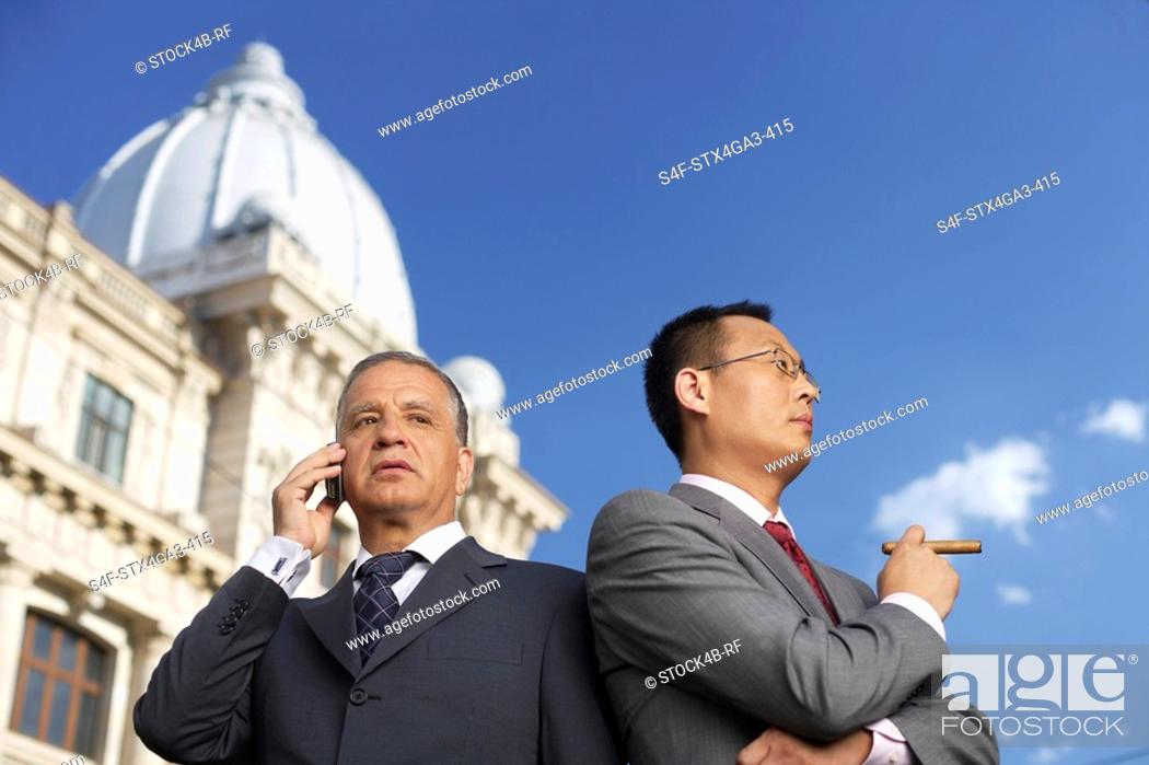 Stock Photo: Two businessman side by side.