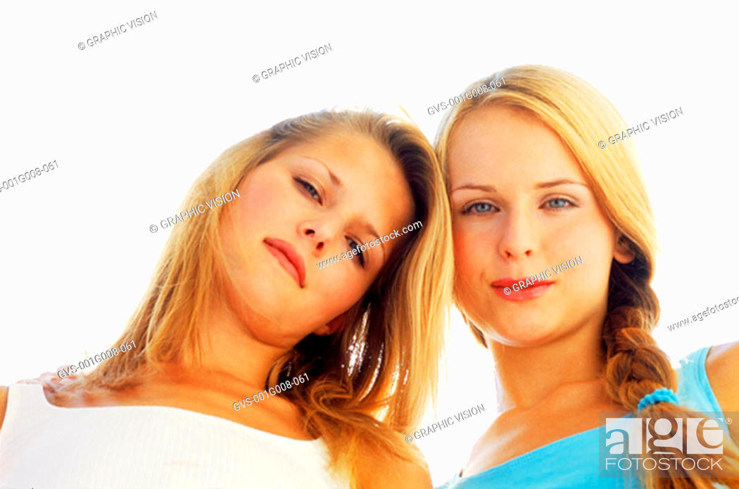 Stock Photo: Low angle view of two young woman looking down.