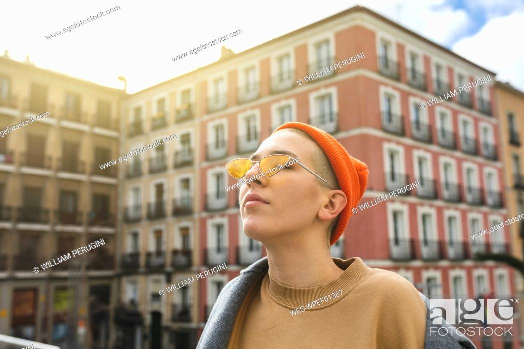 Stock Photo: Portrait of a young woman with closed eyes in the city.