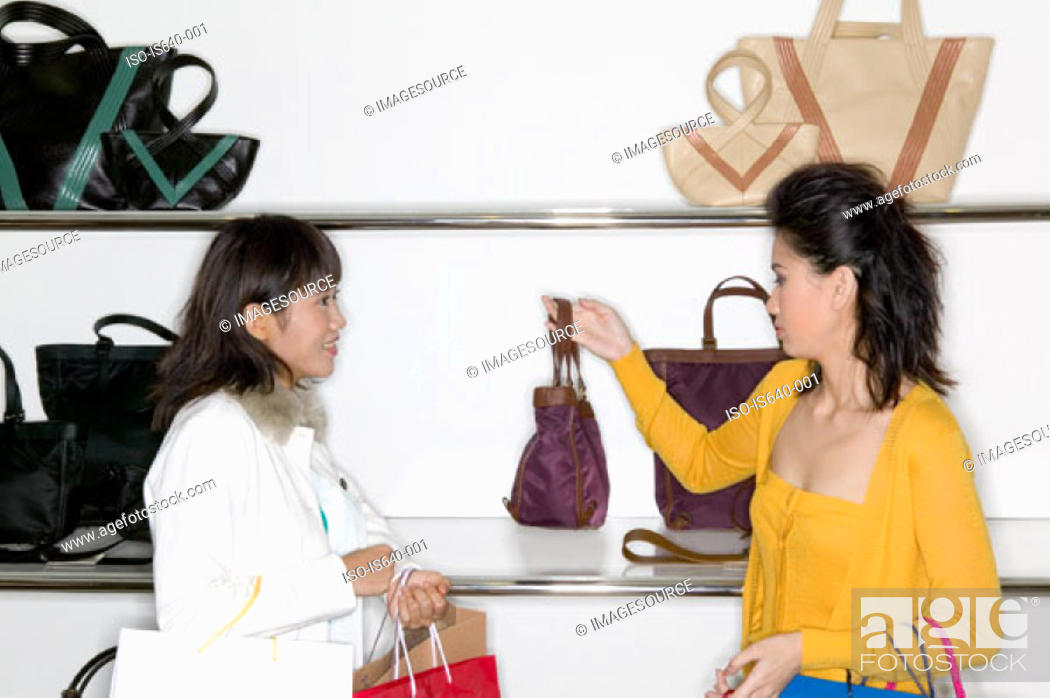 Stock Photo: Women shopping for handbag.