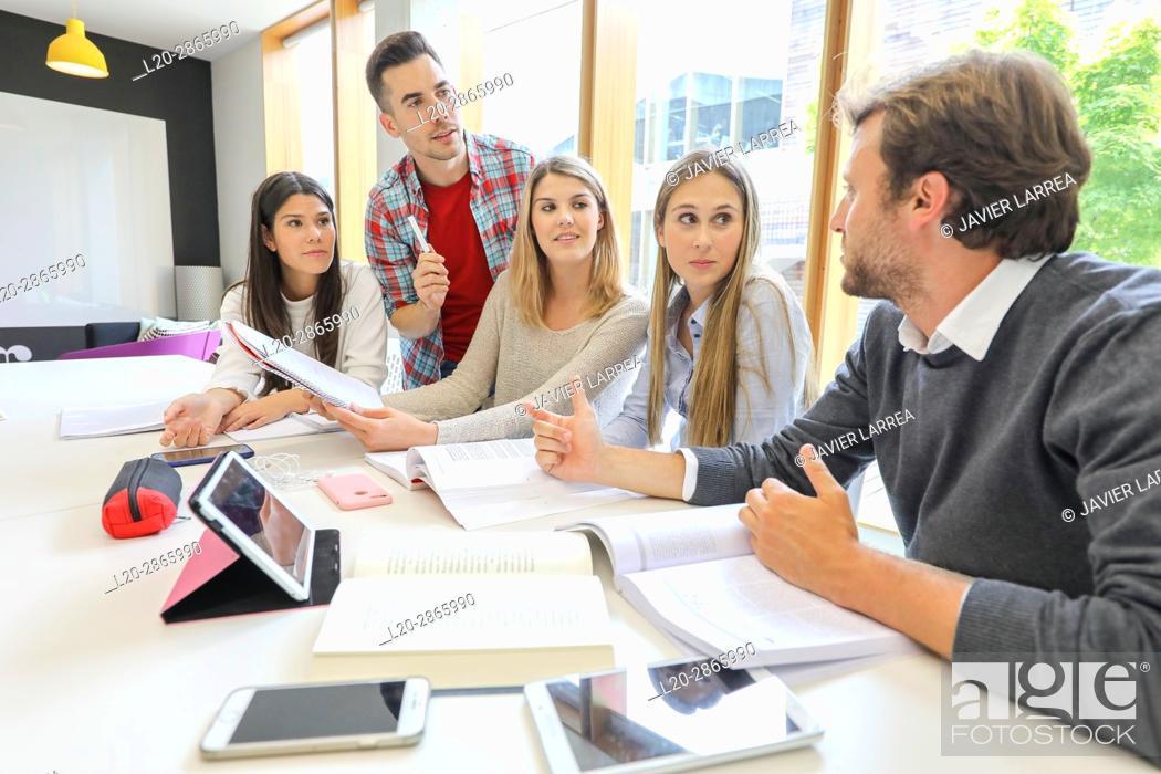 Stock Photo: Teacher with group of students doing a joint work, University of the Basque Country, San Sebastian, Donostia, Gipuzkoa, Spain.