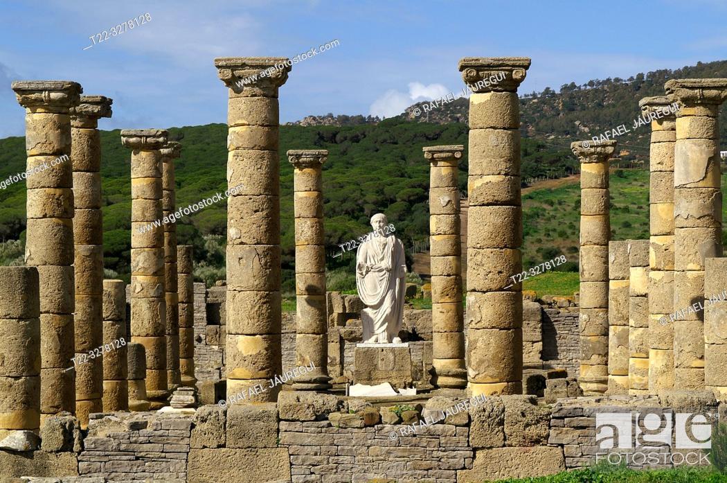 Stock Photo: Rate (Spain). Sculpture between columns of Emperor Trajan in the Roman city of Baelo Claudia.