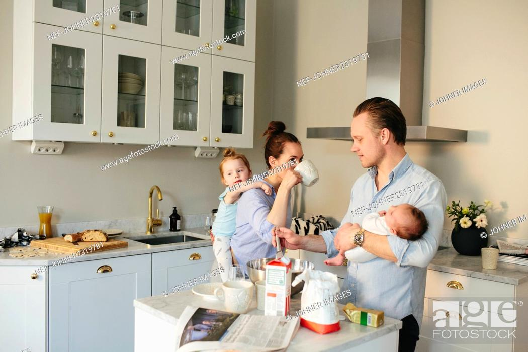 Stock Photo: Family in kitchen.