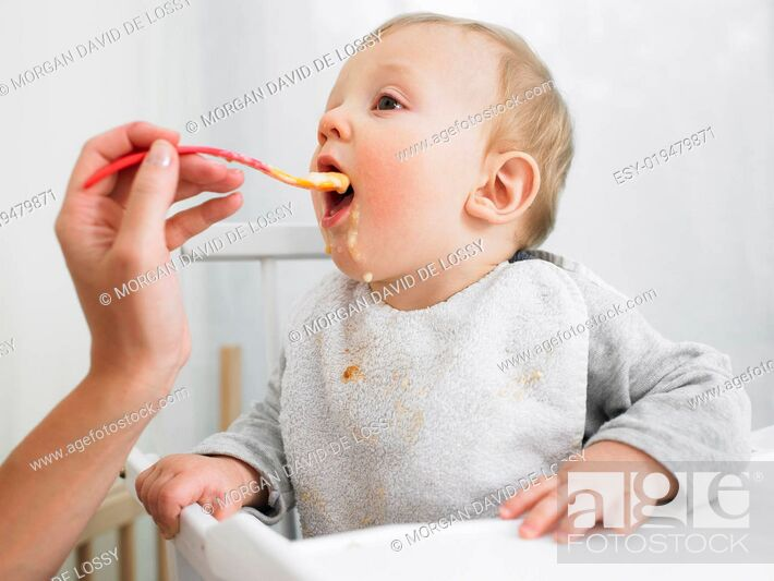 Stock Photo: Baby Being Fed.