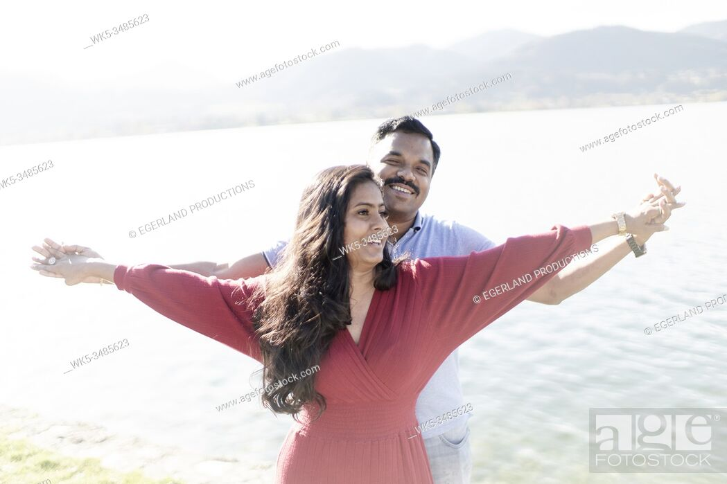 Stock Photo: Indian couple feeling free. Tegernsee, Bavaria, Germany.