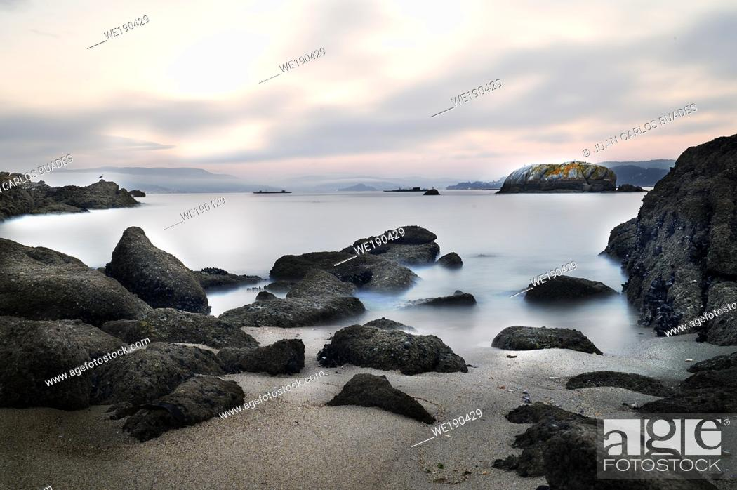 Stock Photo: Photograph of long exposure at sunset on unspoilt beach of the coast of vigo in Galicia.