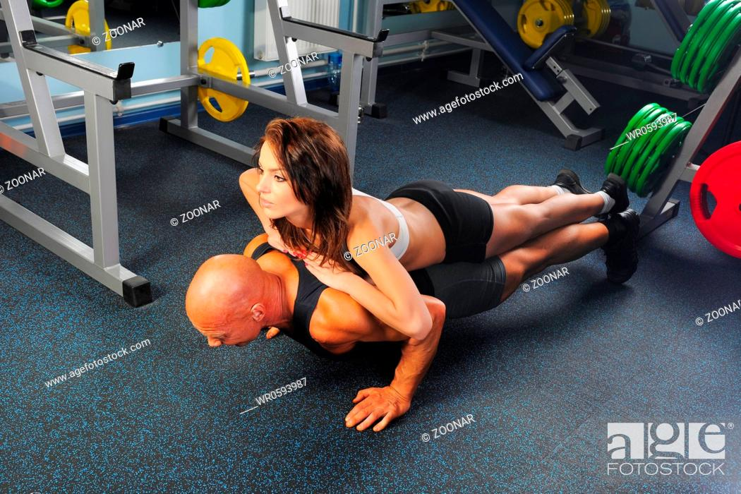 Stock Photo: man and a woman in the gym.