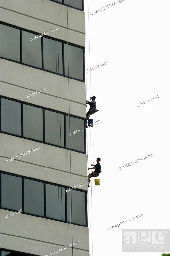Stock Photo: Window washers on building in Columbus, Ohio.