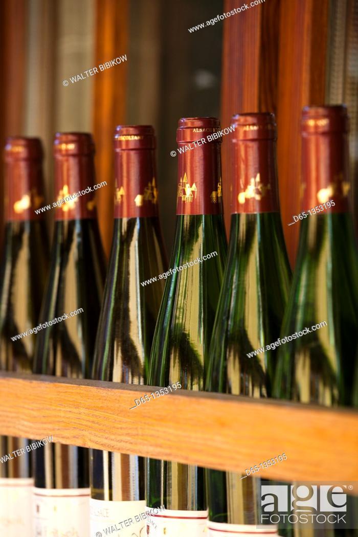 Stock Photo: France, Haut-Rhin, Alsace Region, Alasatian Wine Route, Kaysersberg, wine bottles.
