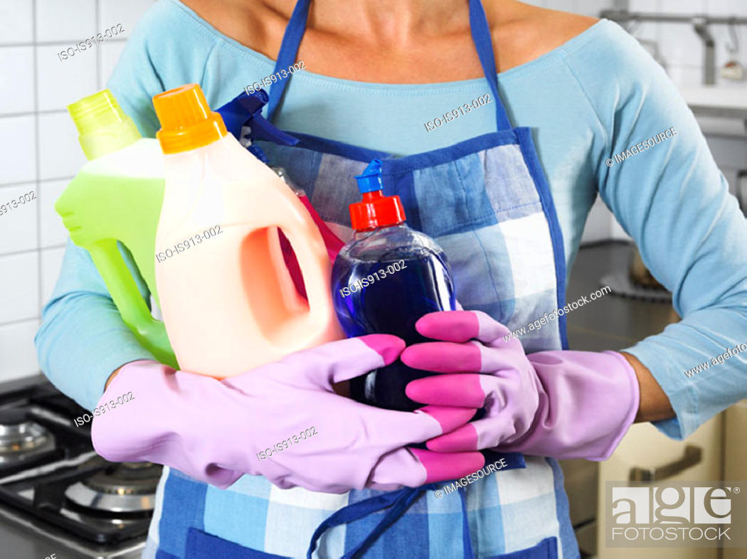 Stock Photo: Woman holding cleaning products.