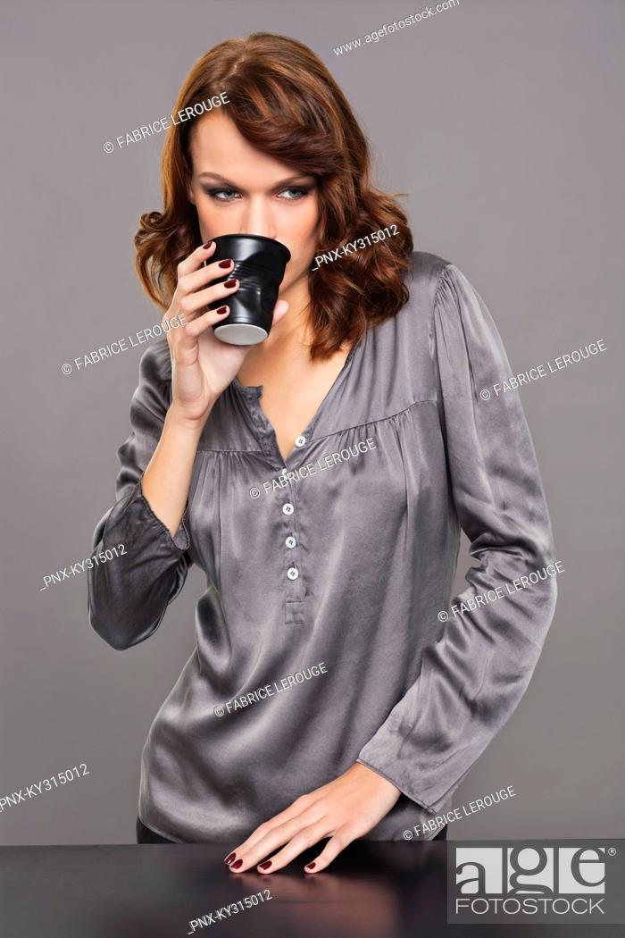 Stock Photo: Young woman drinking coffee.