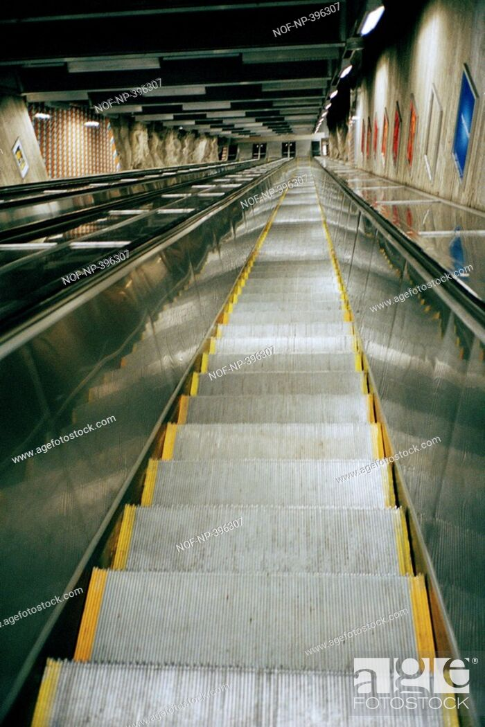 Stock Photo: An escalator moving upwards.