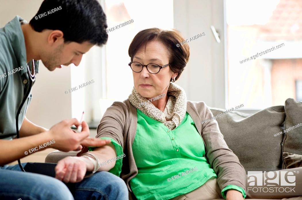 Stock Photo: Male doctor giving an injection to a patient.