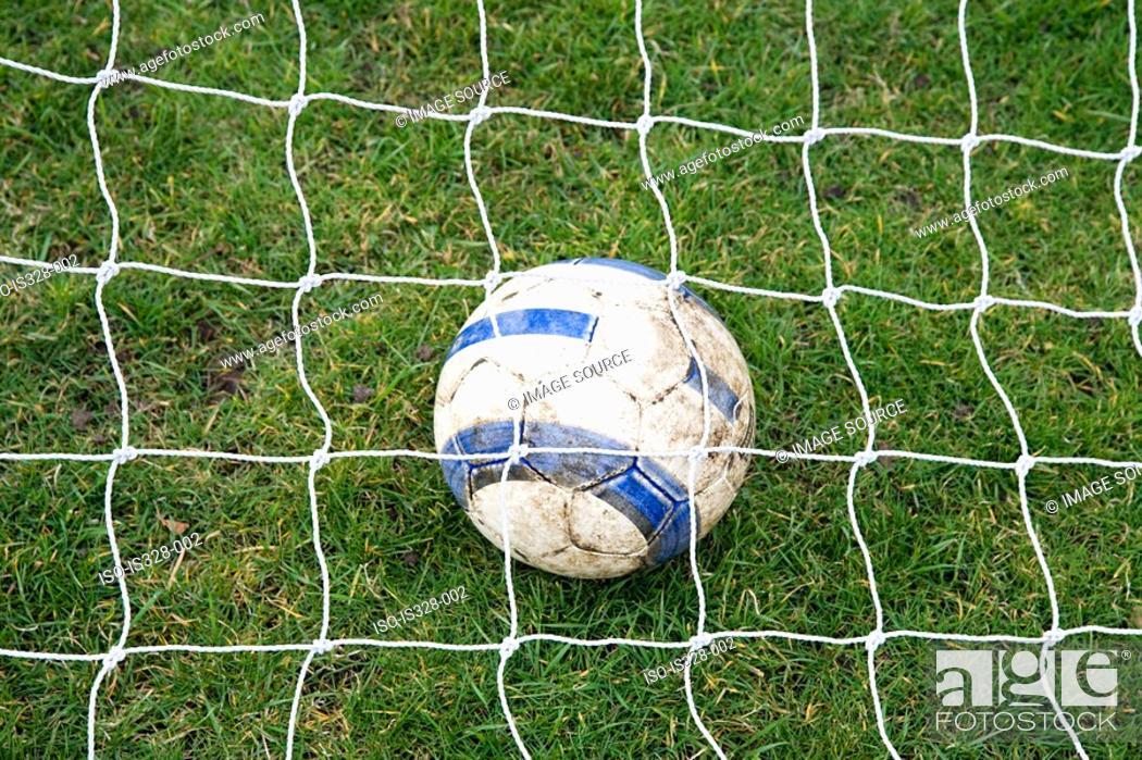 Stock Photo: Football under net.