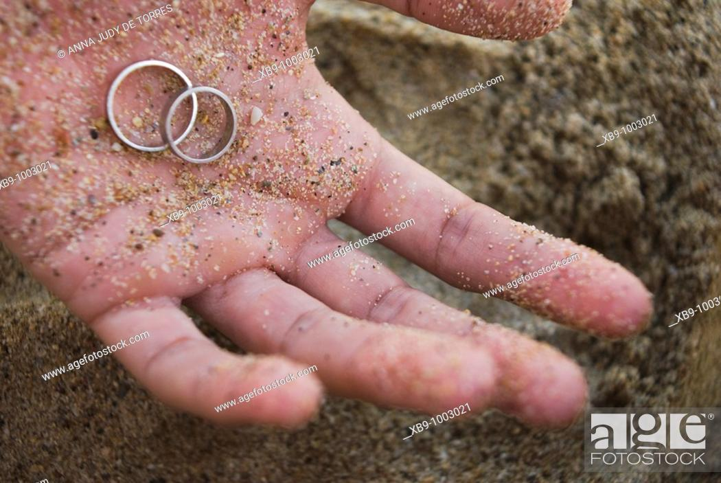 Stock Photo: Hand with wedding rings.