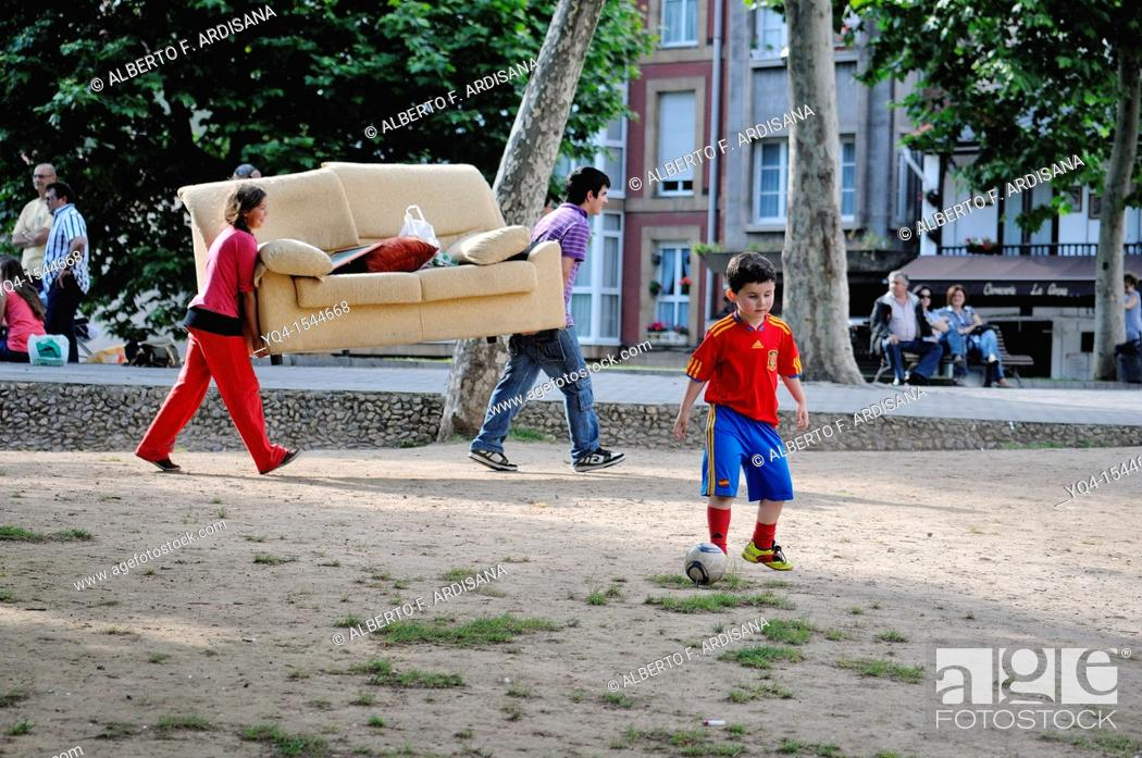 Stock Photo: Children playing in the park, Aviles, Asturias, Spain.