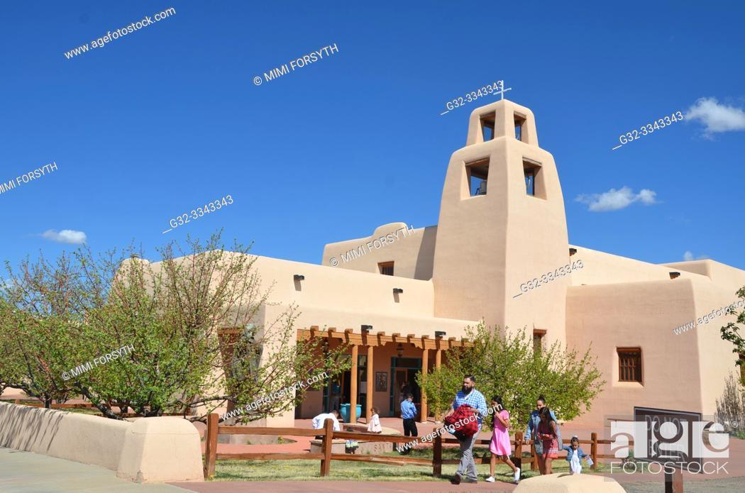 Stock Photo: people leaving church (Santa Maria de la Paz, Santa Fe, New Mexico) after Mass.