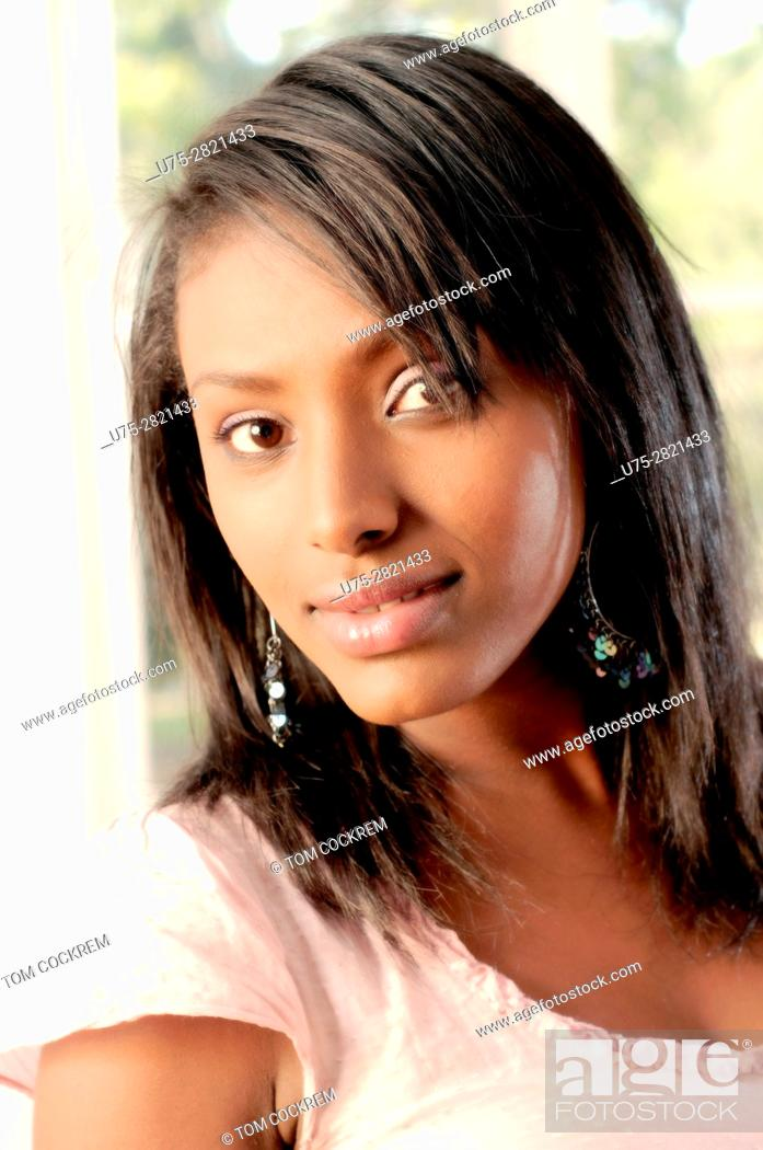 Stock Photo: Young Ethiopian woman in indoors setting.