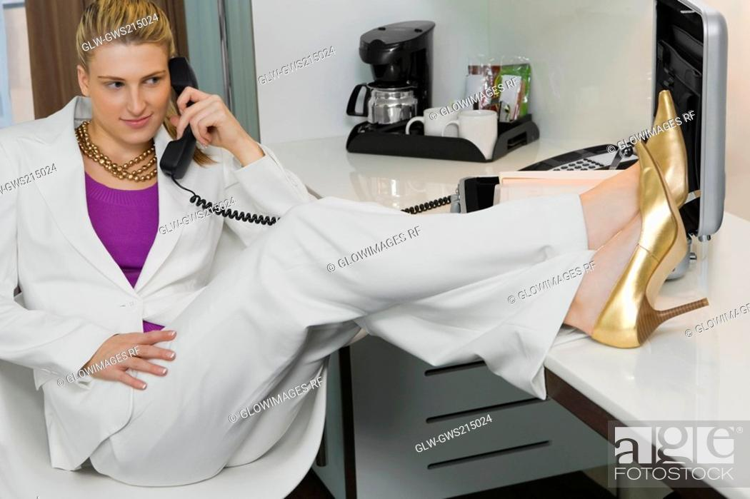 Stock Photo: Businesswoman talking on a phone.