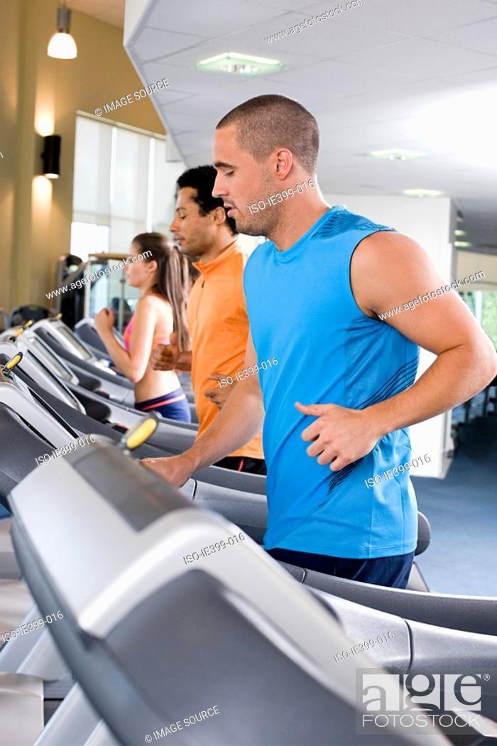 Stock Photo: People on treadmills.