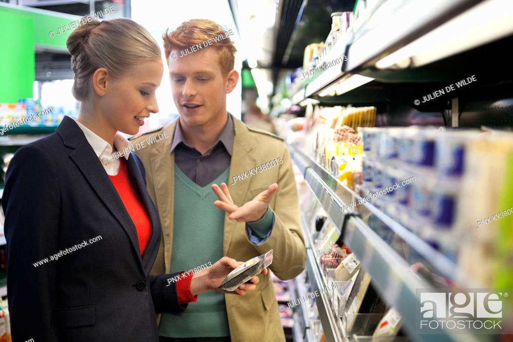 Stock Photo: Couple shopping in a supermarket.
