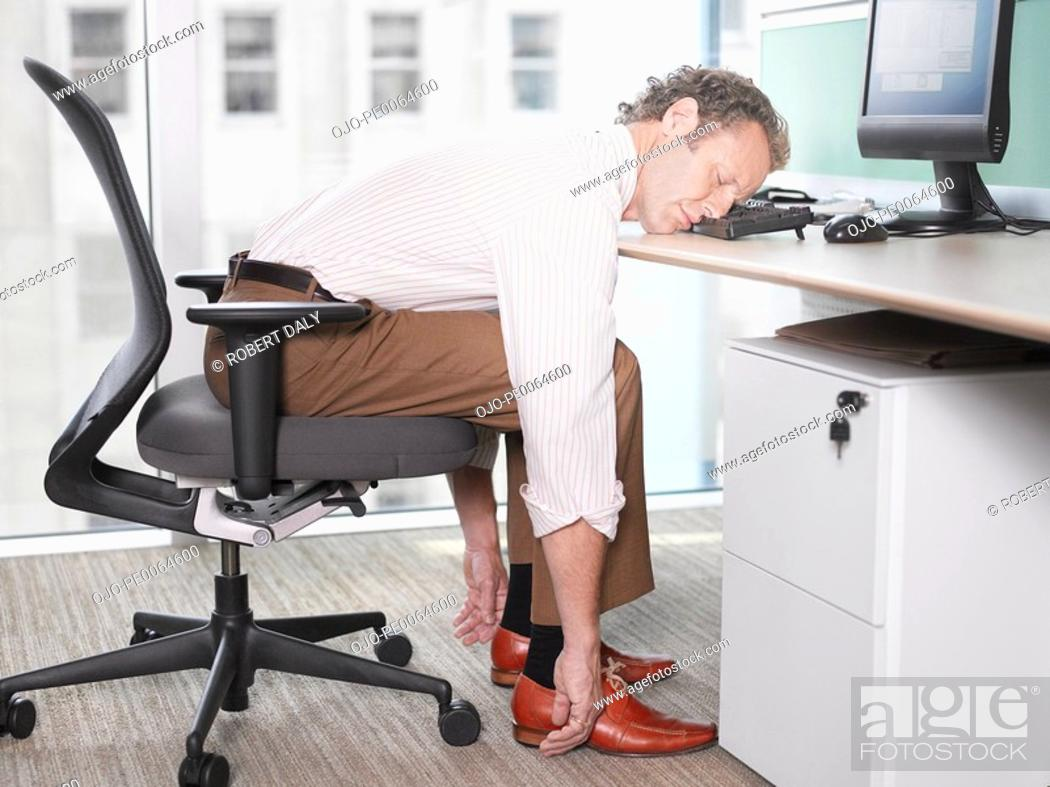 Stock Photo: Businessman sleeping on computer keyboard.