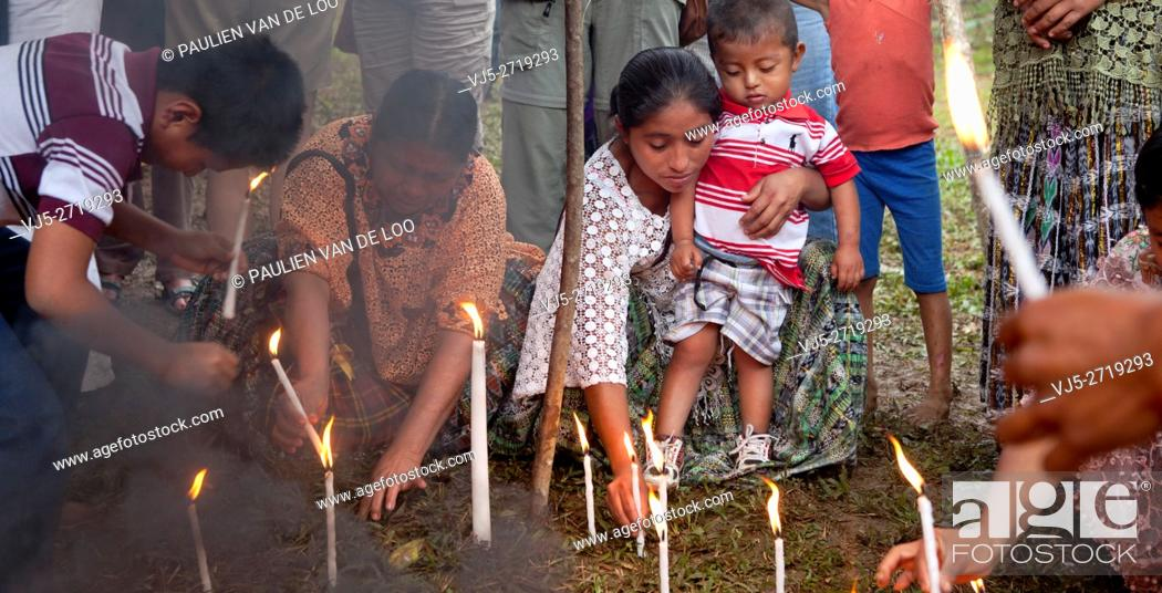 Stock Photo: Chahal, Alta Verapaz, Guatemala, Maya tribe, burning candles are put into the ground for a good harvest and gratitude.