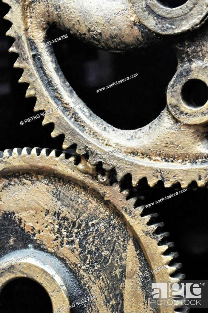 Stock Photo: Yangshou (China): detail of a sculpture made with gears outside a bar along the Walking Street.