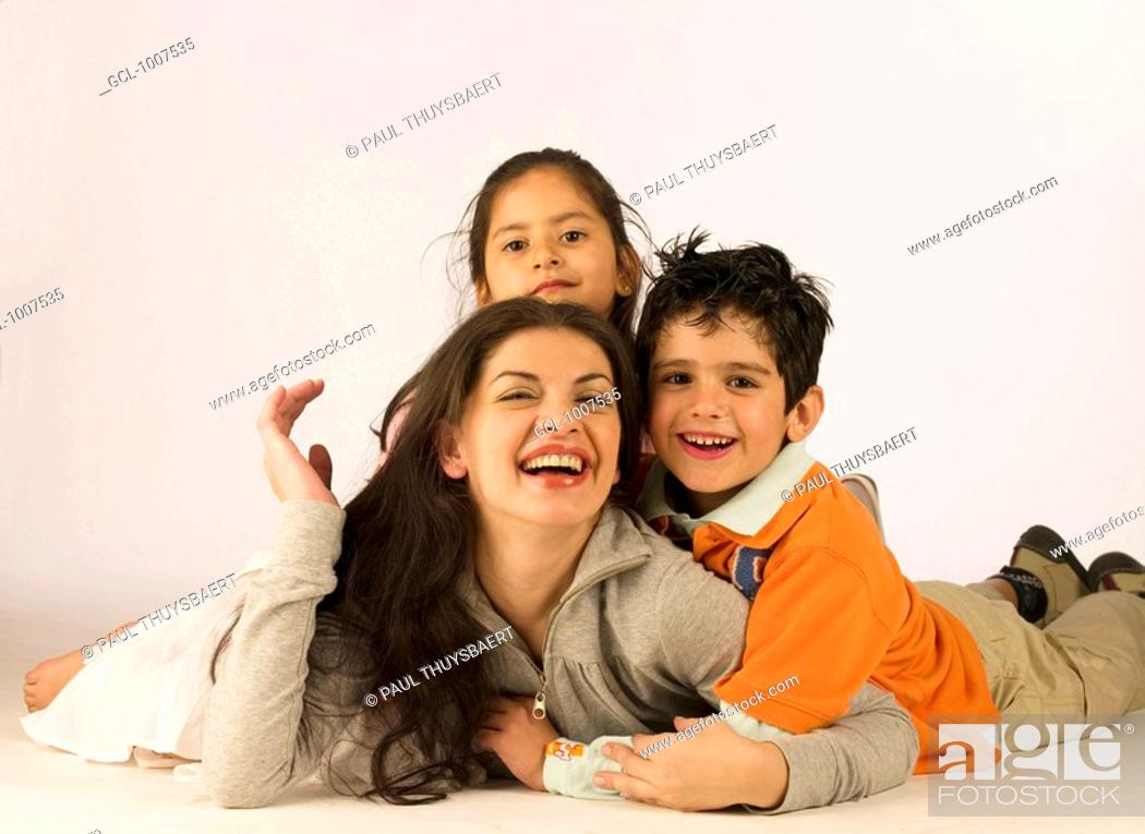 Stock Photo: Mother and her kids having fun.