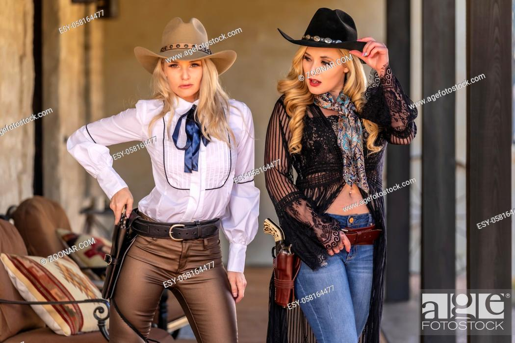 Stock Photo: Two gorgeous blonde models dressed as cowgirls enjoying the outdoor weather.