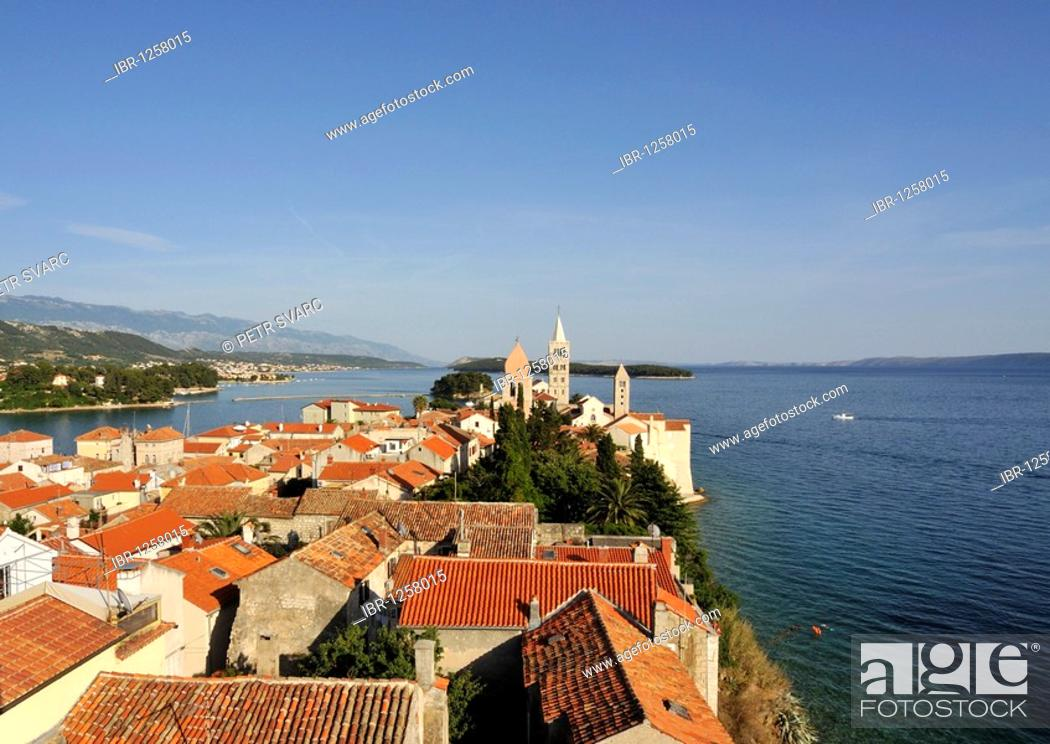 Stock Photo: Oldest quarter of Rab Town, with Belfry of St Justine's Church, Great Bell Tower of St Mary's Cathedral, and Campanile of St Andrew's Monastery as seen from.