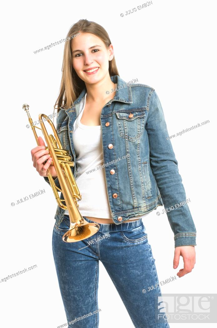 Photo de stock: young woman with her trumpet on white background.