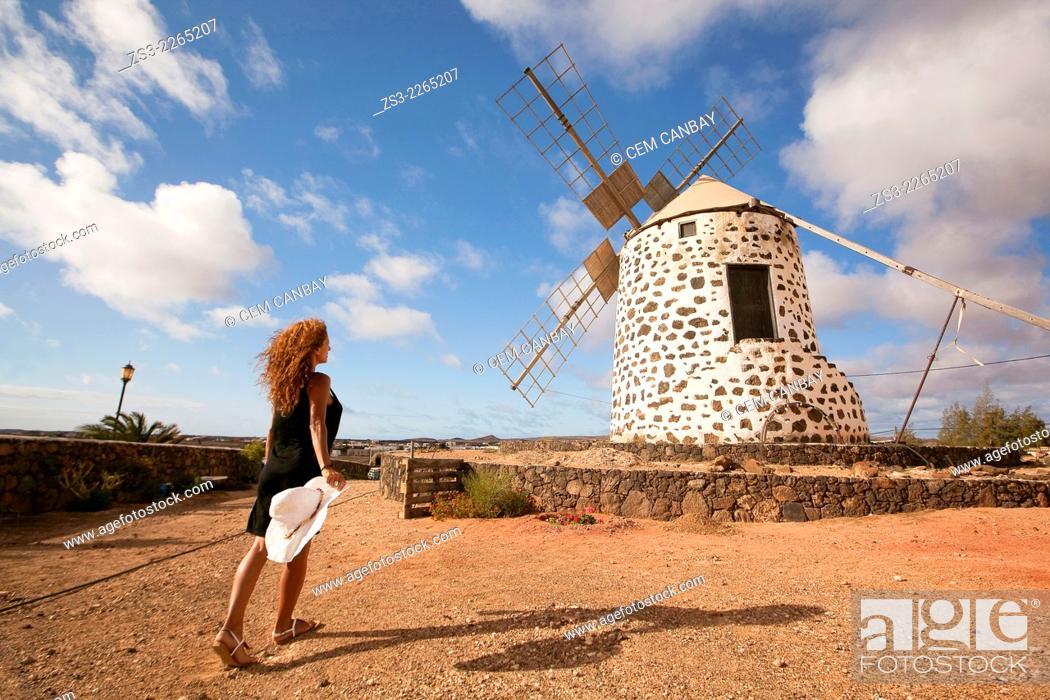 Imagen: Woman posing in front of the windmill near Tefia, La Oliva, Fuerteventura, Canary Islands, Spain, Europe.