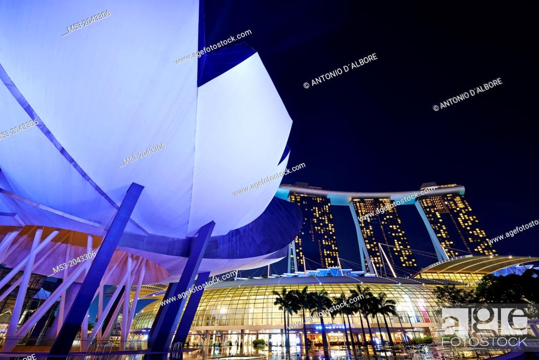 Stock Photo: The flower-shaped Art Science Museum located in the Marina Bay Sands Complex. In the right had side of the image The Shoppes.