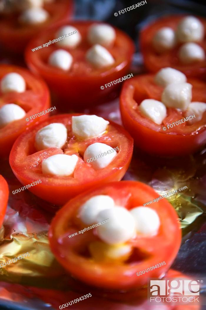 Stock Photo: Group of tomatoes and mozzarella cheese on aluminum foil.
