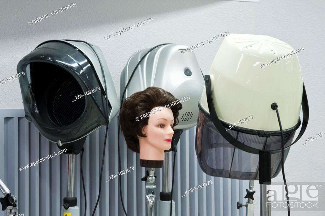 Stock Photo: Hair-dryers in hairdresser.