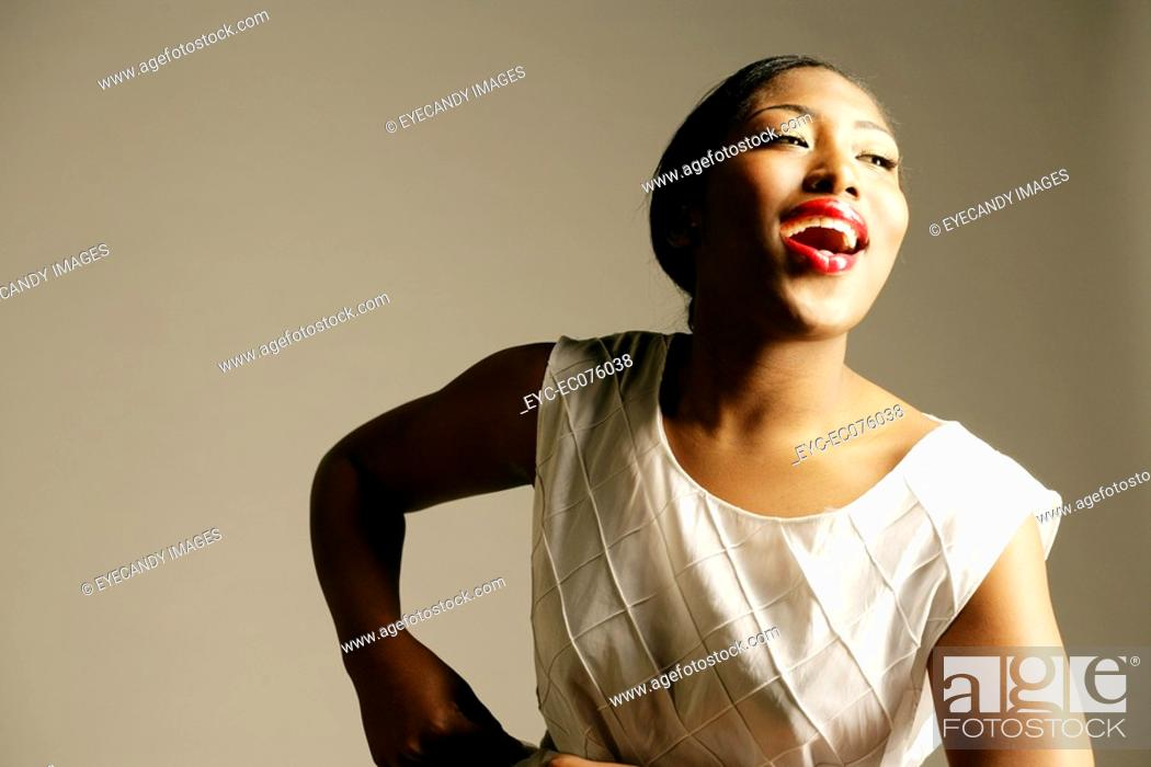 Stock Photo: Young happy African American woman, studio shot.