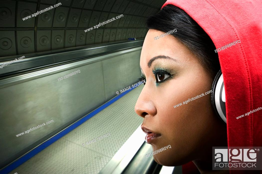 Stock Photo: A young woman listening to music.