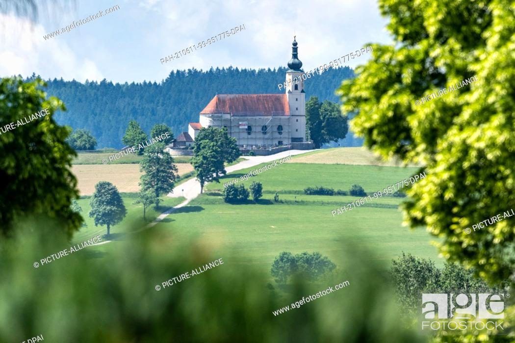 Stock Photo: 11 June 2021, Bavaria, Bad Kötzting: The pilgrimage church of the Assumption of the Virgin Mary in the Weißenregen district. Photo: Armin Weigel/dpa.
