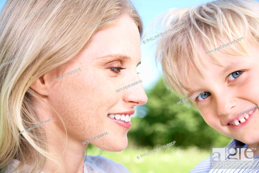 Stock Photo: Germany, Cologne, Mother and son smiling, close up.