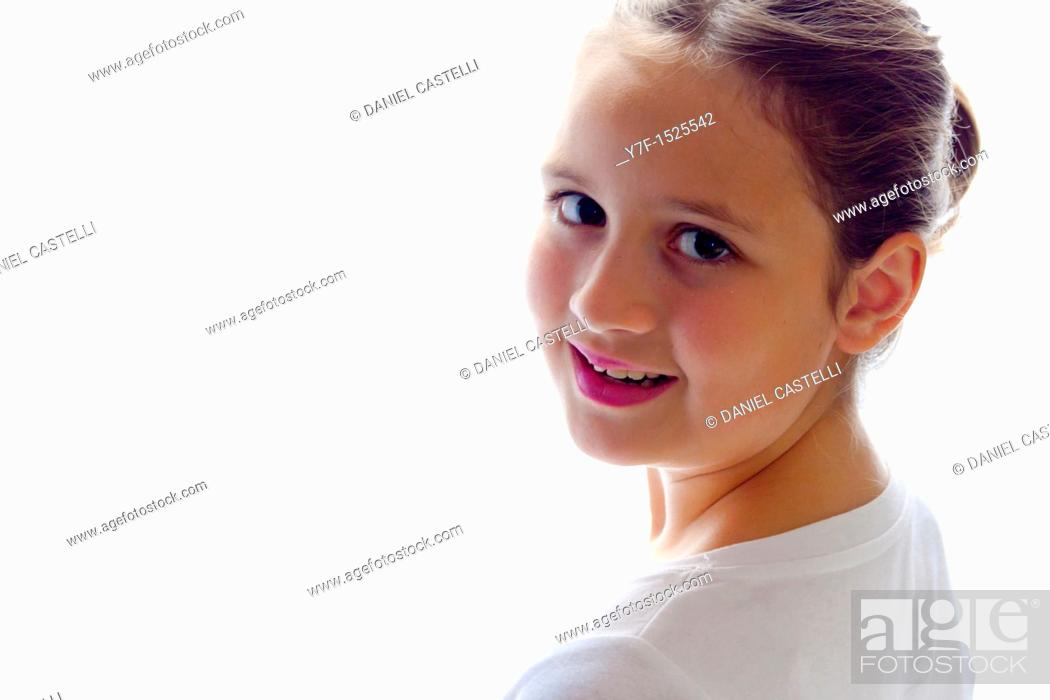 Stock Photo: Brown haired girl smiling.