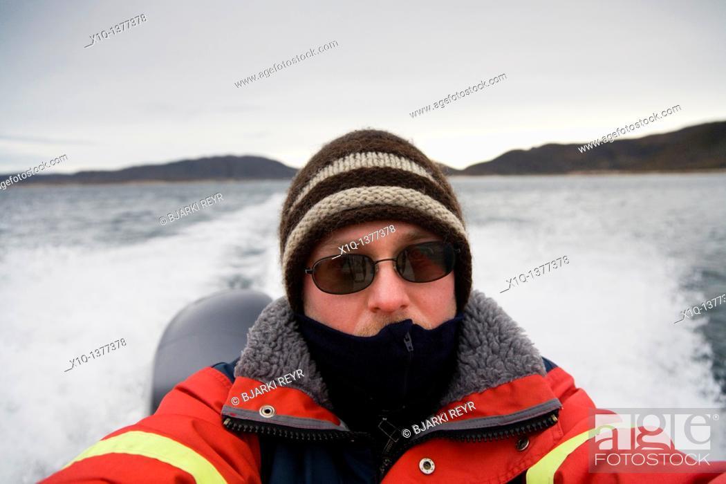 Stock Photo: Passenger on a speedboat self portrait, South Greenland.