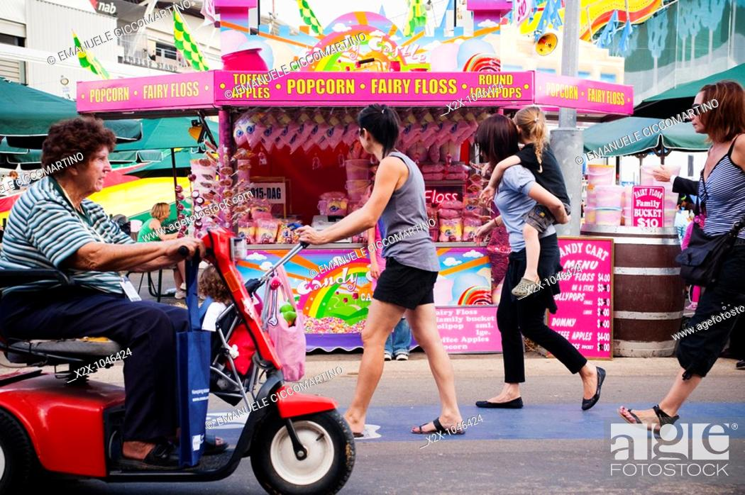 Stock Photo: Visitors walking past the candies kiosk at the Easter Show, Sydney, Australia.