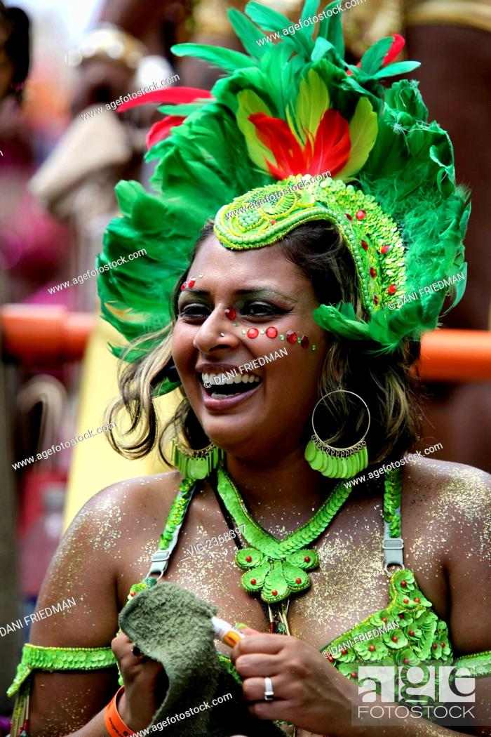 A woman wearing a colorful costume at the Caribana Festival and