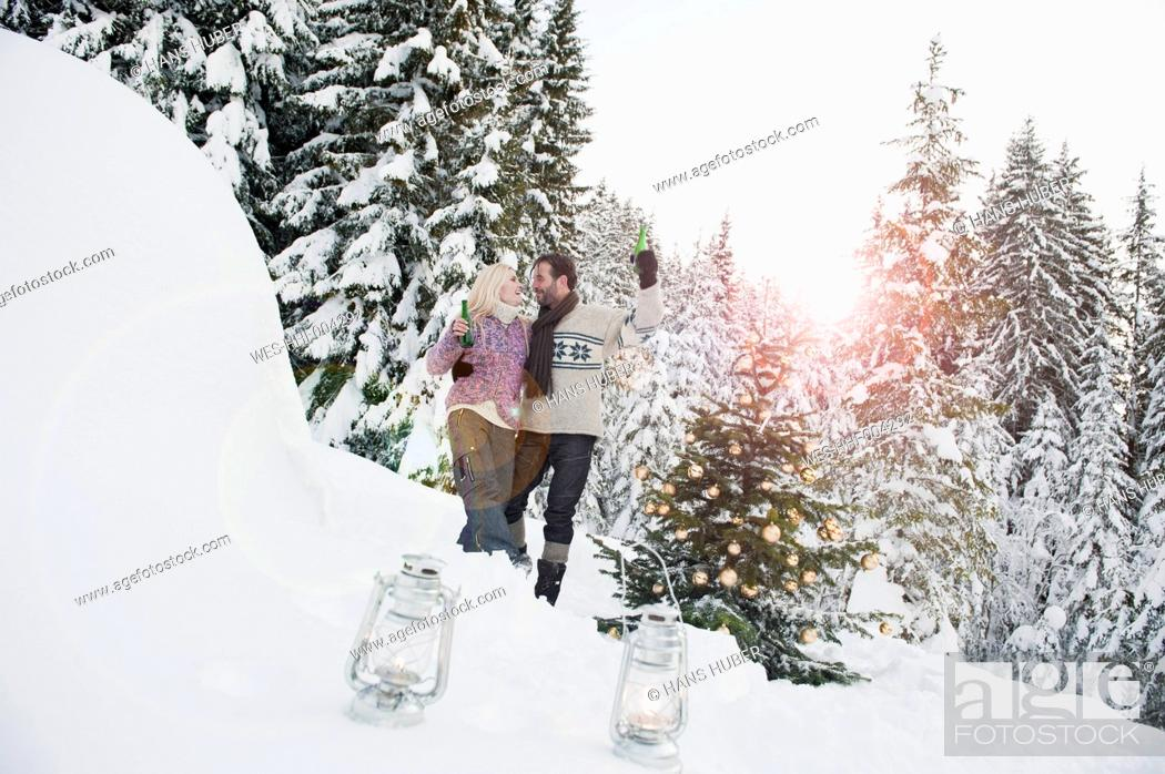 Stock Photo: Austria, Salzburg County, Couple celebrating christmas in snowy landscape.