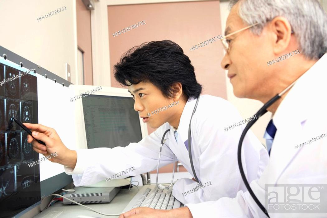 Stock Photo: Doctors looking at X-ray.