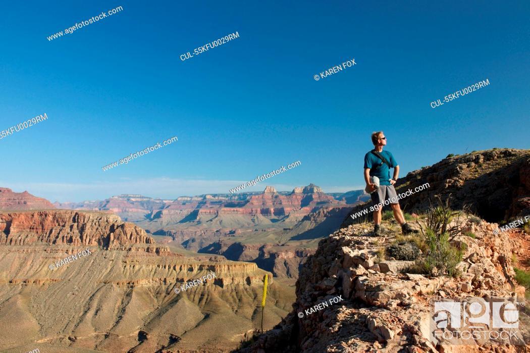 Stock Photo: Man standing on rocks, New Hance, Grandview Hike, Grand Canyon, Arizona, USA.